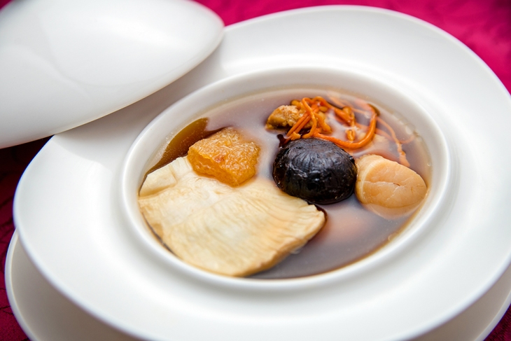 double-boiled-superior-fish-maw-soup-with-fermented-black-garlic-black-chicken-and-cordyceps-flower